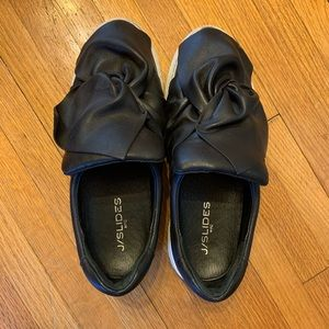 Black leather platform sneakers